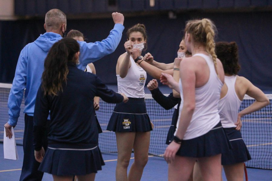 Marquette women's tennis huddles at the. Helfaer March 27 during their Drake meet. (Photo courtesy of Marquette Athletics.)
