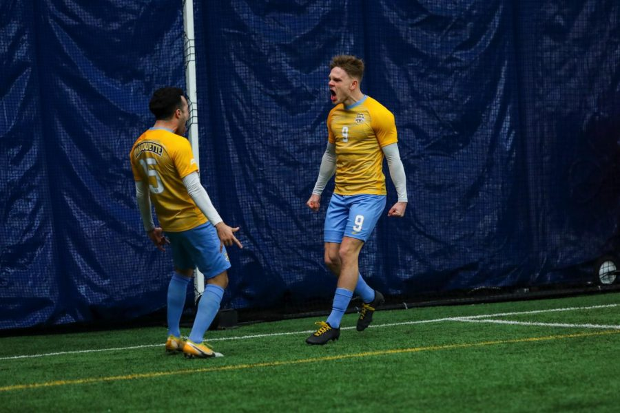 Lukas+Sunesson+%289%29+and+Christian+Marquez+%2815%29+celebrating+during+the+game+against+Northern+Illinois+University+Feb.+7.+%28Photo+courtesy+of+Marquette+Athletics%29.