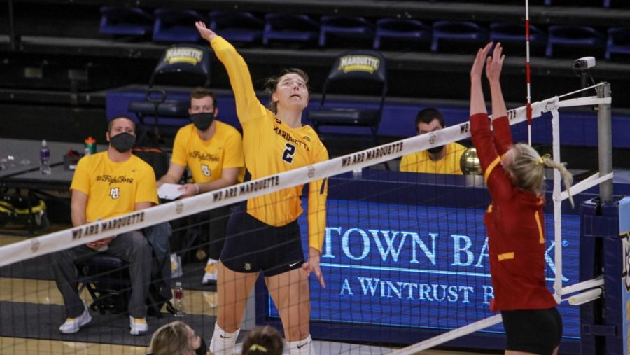 Vanden Berg hits during a match against Iowa State University on Feb. 27 (Photo Courtesy of Marquette Athletics).