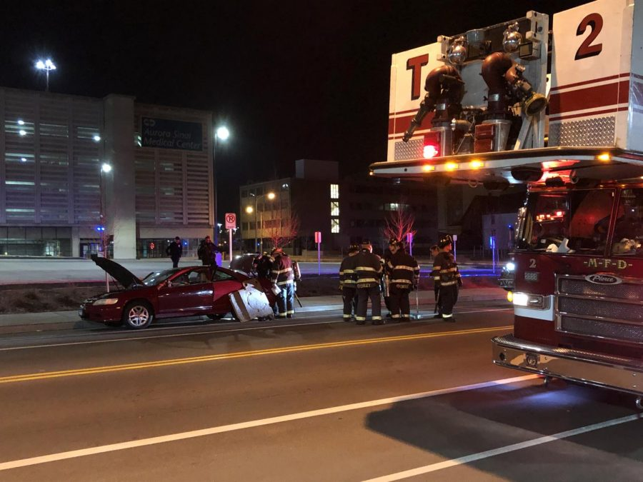 Car fire extinguished near Wells St. parking structure