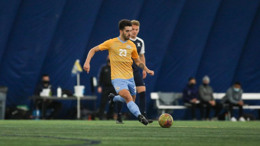 Junior midfielder Zyan Andrade gears up to kick the ball during the squads 2-1 win over Xavier March 17 (Photo courtesy of Marquette Athletics.)