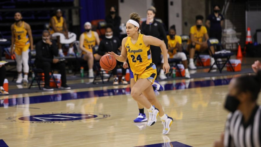 Selena Lott (24) dribbles in Marquette's 87-82 loss to DePaul on Feb. 7 2021. (Photo courtesy of Marquette Athletics.)