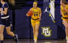 Selena Lott (24) brings up the ball in Marquette's 65-57 win over Villanova on Feb. 19 2021. (Photo courtesy of Marquette Athletics.)