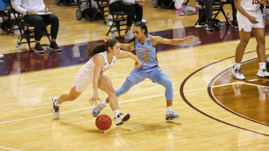 Taylor Valladay (5) defending in Marquettes 70-63 loss to Virginia Tech in the NCAA Tournament March 21 2021. (Photo courtesy of Marquette Athletics.)