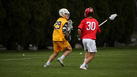 Redshirt first-year attacker Devon Cowan (29) works his way past a St. Johns defender April 14. He scored the game-winning goal in the fourth overtime period Saturday afternoon (Photo courtesy of Marquette Athletics.)