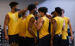 The Marquette men's basketball team huddles during a team workout (Photo courtesy of Marquette Athletics.)