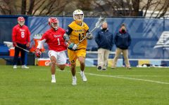 Redshirt senior midfielder Connor McClelland (13) looks on after moving past a St. John's defender April 14. He posted a hat trick Saturday afternoon against the Villanova Wildcats (Photo courtesy of Marquette Athletics.)