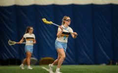 Redshirt senior attacker Megan Menzuber looks to make a pass to an open teammate (Photo courtesy of Marquette Athletics.)