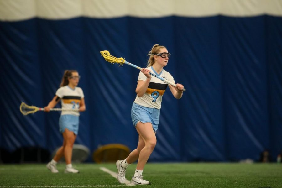 Redshirt+senior+attacker+Megan+Menzuber+looks+to+make+a+pass+to+an+open+teammate+%28Photo+courtesy+of+Marquette+Athletics.%29+