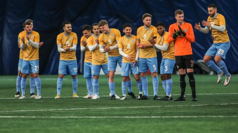 The Marquette mens soccer team lines up prior to a match against Northern Illinois Feb. 7 (Photo courtesy of Marquette Athletics.)