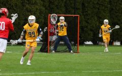 Redshirt first-year goalie Sean Richard (72) directs his teammates during the team's game against St. John's April 14 (Photo courtesy of Marquette Athletics.)