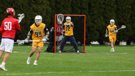 Redshirt first-year goalie Sean Richard (72) directs his teammates during the team