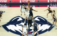 Forward Camryn Taylor (15) goes up for a jump ball against the UConn Huskies (Photo courtesy of Marquette Athletics.)
