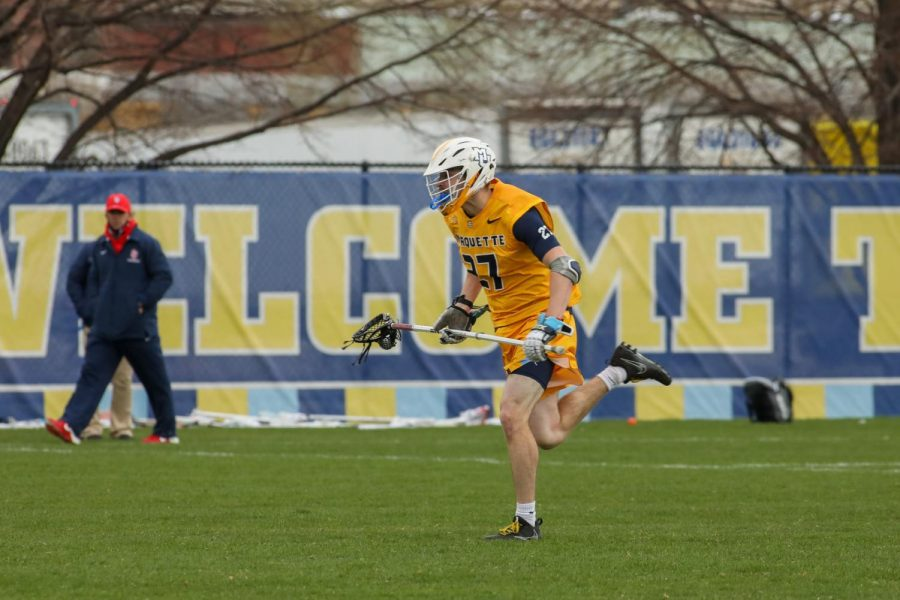 Redshirt sophomore defenseman Zach Granger (27) moves downfield during a game against St. John's April 14 (Photo courtesy of Marquette Athletics.)