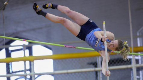 Brielle Buechler pole vaults during the Marquette Open April 24. (Photo courtesy of Marquette Athletics.)