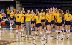 The women's volleyball team celebrates after the Iowa State game Feb. 27 at the Al McGuire Center. (Photo courtesy of Marquette Athletics.)