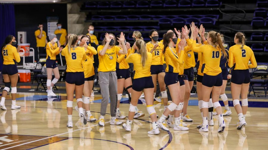 The+women%27s+volleyball+team+celebrates+after+the+Iowa+State+game+Feb.+27+at+the+Al+McGuire+Center.+%28Photo+courtesy+of+Marquette+Athletics.%29