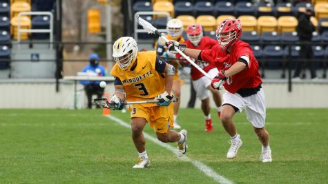 Redshirt sophomore Thomas Washington (3) battles for the ball against an SJ defender April 14. The Golden Eagles beat the Red Storm for the second time this season Friday afternoon (Photo courtesy of Marquette Athletics.)