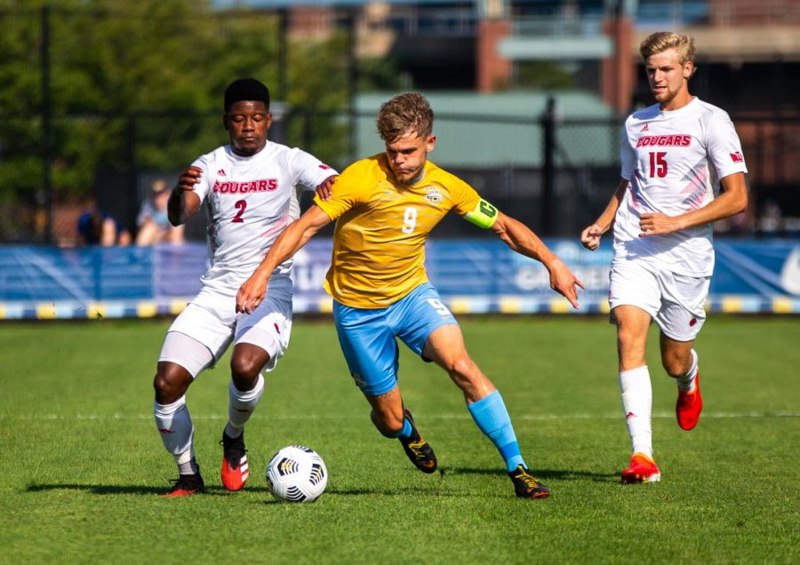 Lukas Sunesson (9) dribbles through two Southern Illinois University of Edwardsville defenders in Marquette's 4-3 comeback win Aug. 29.