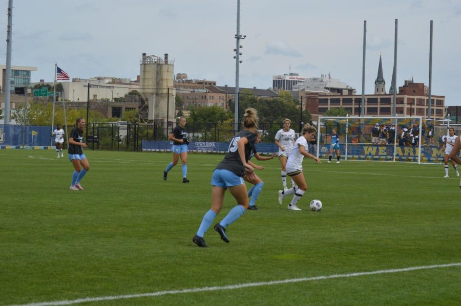 Marquette womens soccers defense takes on a Notre Dame forward.