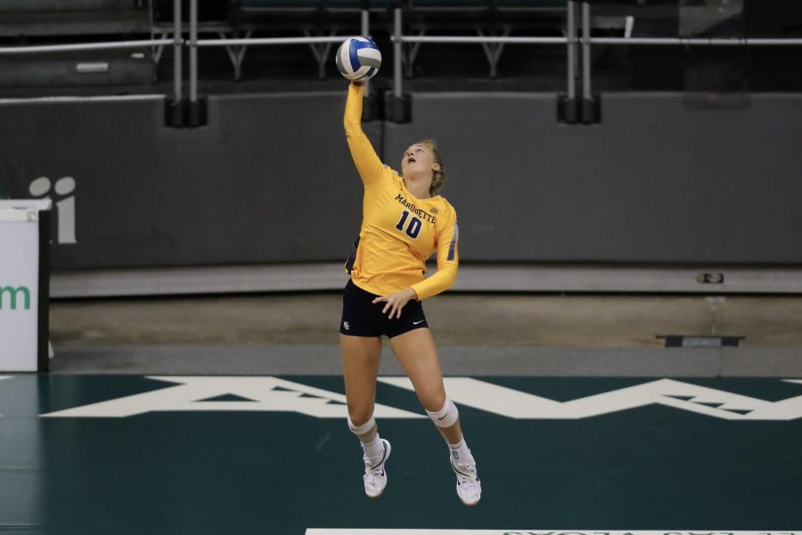 Taylor+Wolf+%2810%29+goes+up+for+a+serve+in+Marquettes+sweep+over+the+University+of+Hawaii+Aug.+28+2021.+%28Photo+courtesy+of+Marquette+Athletics.%29