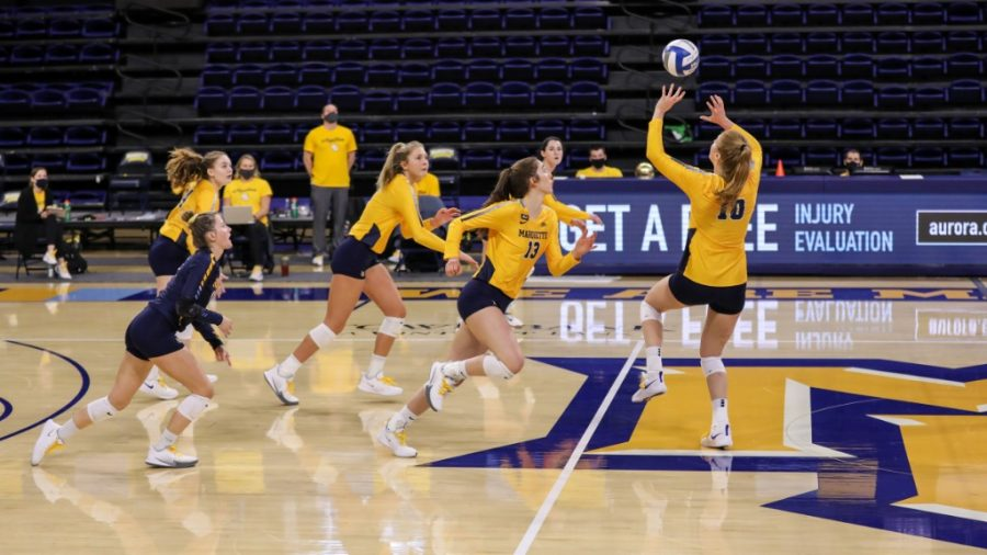 Taylor Wolf (10) sets a pass in Marquettes 3-0 win over Iowa State Feb. 27. (Photo courtesy of Marquette Athletics.)