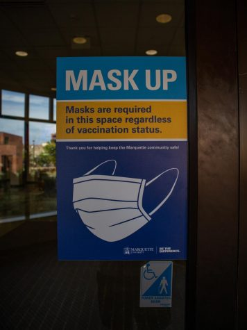 Mask Up Marquette posters encourage students to wear their masks in indoor public spaces.