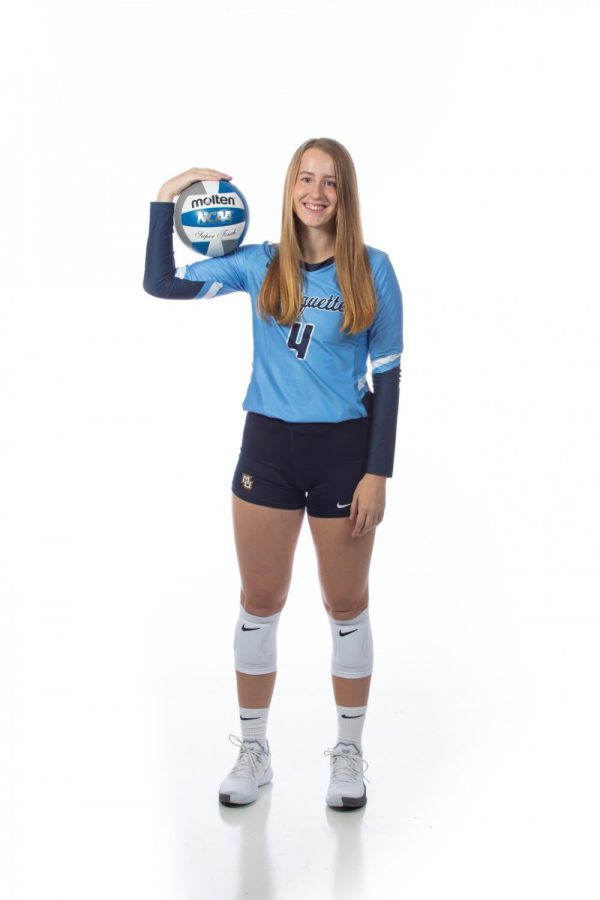 Jenna Reitsma (4) is a first-year outside hitter from Lowell, Michigan. (Photo courtesy of Marquette Athletics.)