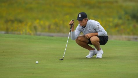 First-year golfer Max Lyons lines up his putt. (Photo courtesy of Marquette Athletics.)