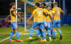 Marquette mens soccer celebrates after redshirt sophomore forward Christian Marquezs goal in its 2-1 victory over Kansas City Sept.3.
