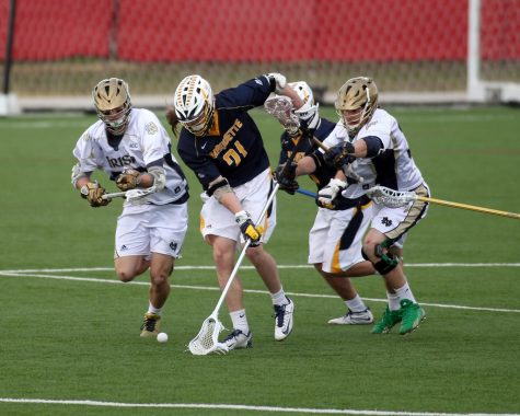 Liam Byrnes (21) goes for a ground ball in Marquettes 12-7 loss to Notre Dame April 8 2014. (Photo courtesy of Marquette Athletics.)
