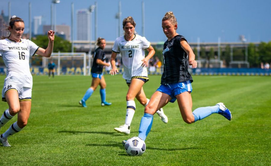 Kylie Sprecher (8) takes a kick in Marquettes 1-0 loss to Notre Dame Aug. 29.