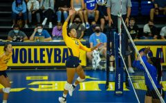Carsen Murray (12) goes up for a kill in Marquette's 0-3 loss to No. 8 University of Kentucky Sept. 11.