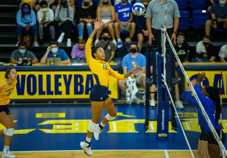 Carsen Murray (12) goes up for a kill in Marquettes 0-3 loss to No. 8 University of Kentucky Sept. 11.