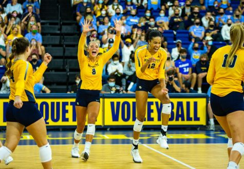 Marquette volleyball celebrates during its 0-3 loss to No. 8 Kentucky Sept. 11.