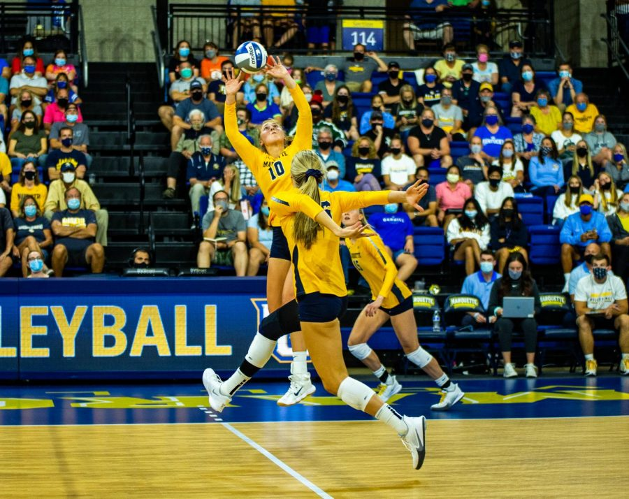 Graduate student outside hitter Taylor Wolfe sets up a pass in Marquettes 3-0 loss to No. 8 Kentucky Sept. 11.