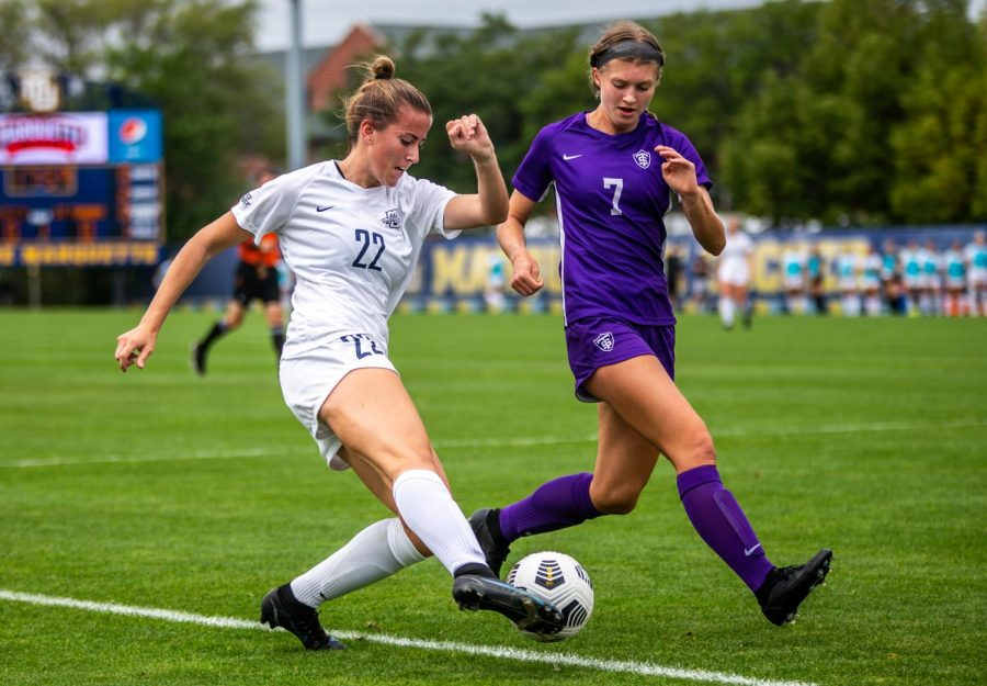 Elsi Twombly (22) makes a move heading to goal on a University of St. Thomas defender in Marquettes 3-0 win Sept. 12.