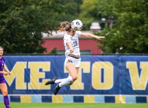 First-year forward Maggie Starker scores off the header in Marquettes 3-0 win over the University of St. Thomas Sept. 12.