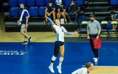 Savannah Rennie (16) serves the ball in Marquette's 3-0 win over the University of Texas San-Antonio Sept. 17.