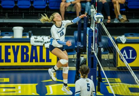 Ellie Koontz (15) finishes off a swing in Marquettes 3-0 win over the University of Texas-San Antonio.