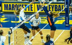 Savannah Rennie (16) finishes a kill in Marquette's 3-0 win over the University of Texas San Antonio Sept. 17.