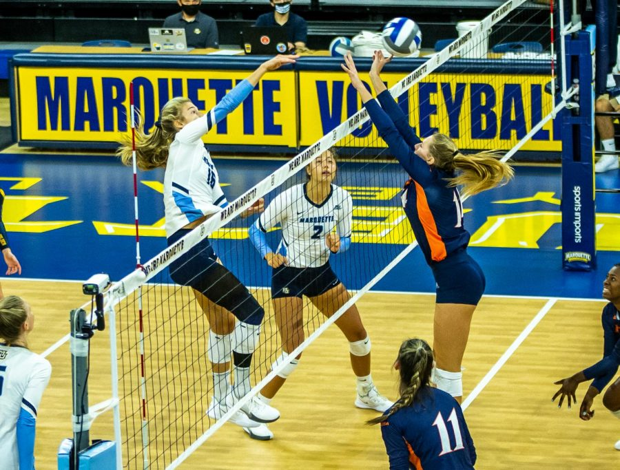 Savannah Rennie (16) finishes a kill in Marquettes 3-0 win over the University of Texas San Antonio Sept. 17.