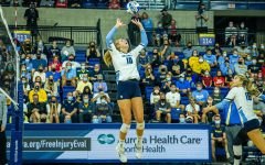 Taylor Wolf (10) sets up a pass in Marquette's 0-3 loss to No. 8 Kentucky Sept. 11.