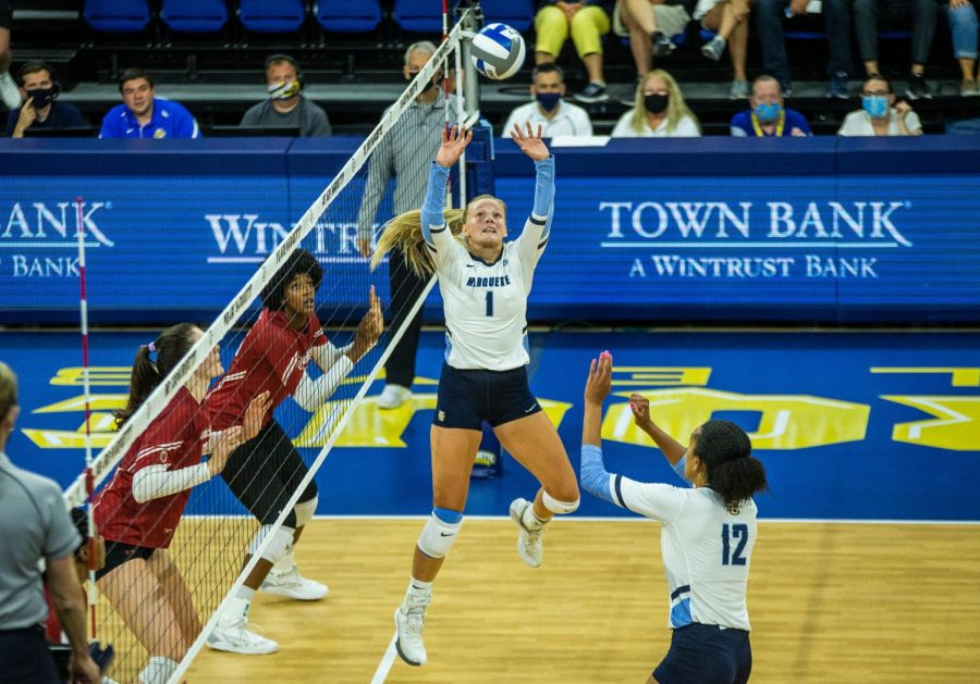Claire Mosher (1) serves up a ball in Marquettes 0-3 loss to No. 2 Wisconsin Sept. 12.
