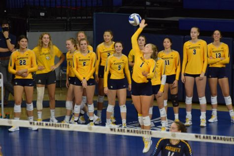 Claire Mosher (1) serves the ball in Marquettes 3-0 win over Northern Iowa Sept. 18.