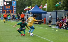 Edrey Caceres (6) makes a move on a University of Wisconsin-Green Bay defender in Marquette's 2-0 win Aug. 26. (Photo courtesy of Marquette Athletics.)