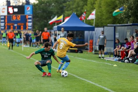 Edrey Caceres (6) makes a move on a University of Wisconsin-Green Bay defender in Marquettes 2-0 win Aug. 26. (Photo courtesy of Marquette Athletics.)