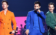 Pictured above are the Jonas Brothers (left to right) Nick, Joe and Kevin performing on their 2019