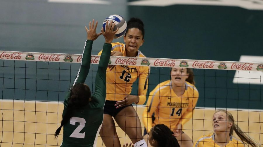 Carsen Murray (12) goes up for a block in Marquettes 3-0 win over Hawaii Aug. 28. (Photo courtesy of Marquette Athletics.)