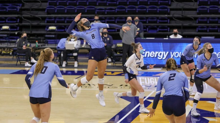 Hope Werch (8) goes up for a kill in Marquettes 3-0 win over DePaul Feb. 12. (Photo courtesy of Marquette Athletics.)